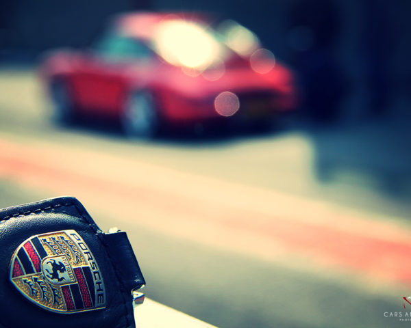 Porsche Key and 911 Carrera in Background